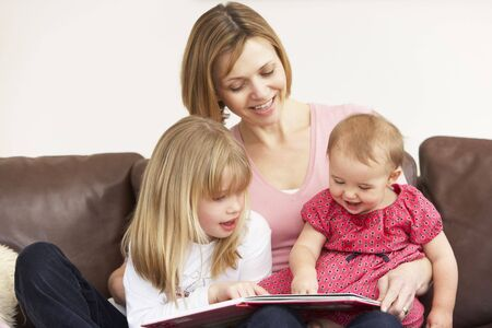 Mother And Daughters Reading Book photo