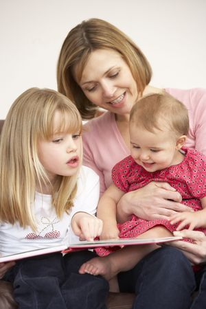 Mother And Daughters Reading Book Stock Photo - 4645041