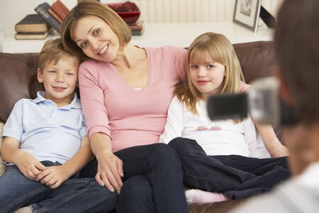 Mother And Children On Sofa Being Filmed On Video Camera Stock Photo - 4645023