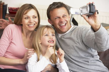 taking video: Couple And Daughter Using Computer