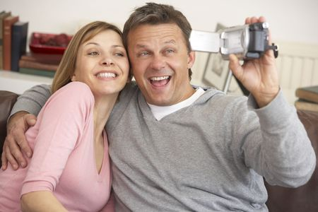 Couple With Video Camera Stock Photo - 4645139