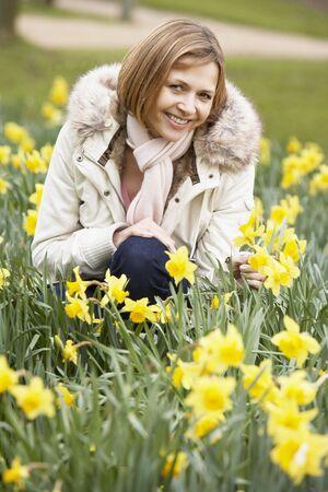 woman kneeling: Woman Kneeling In Daffodils