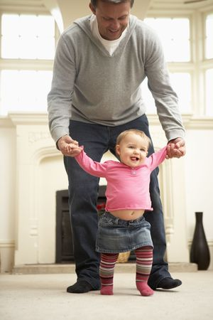 Father Helps Baby Daughter With Walking Stock Photo - 4645077