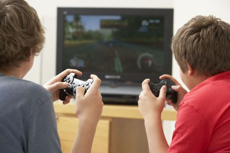 teens playing: Two Boys Playing With Game Console Stock Photo