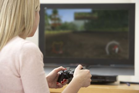 Young Woman Playing With Game Console photo