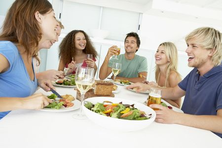 gathering: Friends Having Lunch Together At Home