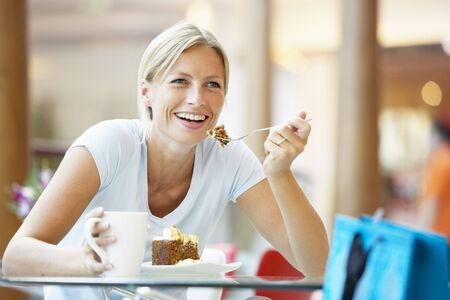Woman Eating A Piece Of Cake At The Mall Stock Photo - 4645118