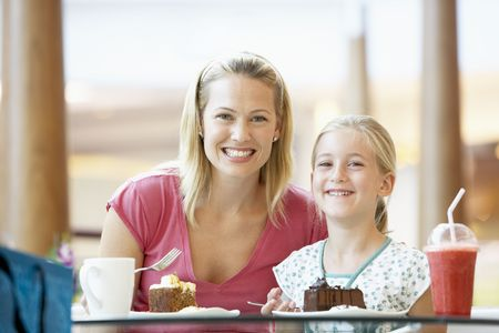 food court: Mother And Daughter Having Lunch Together At The Mall Stock Photo
