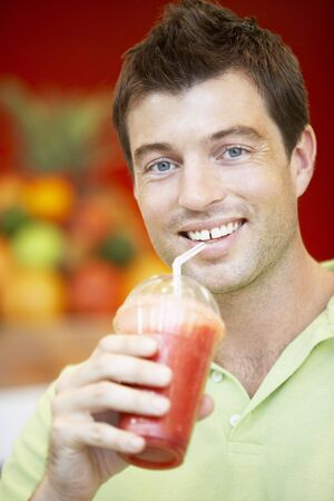 Man Drinking A Berry Smoothie photo