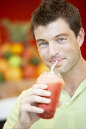 Man Drinking A Berry Smoothie Stock Photo - 4645125