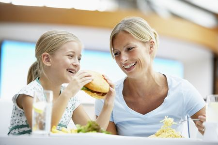 having lunch: Mother And Daughter Having Lunch Together At The Mall Stock Photo