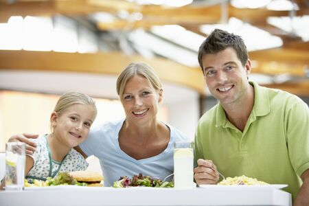 Family Having Lunch Together At The Mall photo