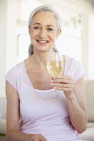 Woman Enjoying A Glass Of White Wine photo