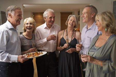 entertaining: Man Serving Hors Doeuvres To His Guests At A Dinner Party