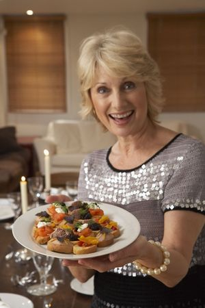 Woman With Hors Doeuvres For A Dinner Party photo