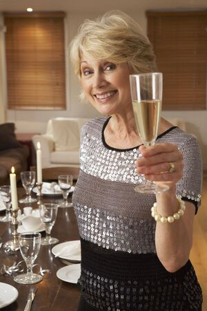 Woman Throwing A Dinner Party photo