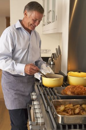 Man Cooking At Home Stock Photo - 4646005