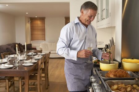 Man Preparing Food For A Dinner Party Stock Photo - 4646063