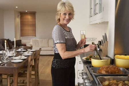 Woman Preparing Food For A Dinner Party photo