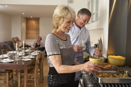 Couple Preparing Food For A Dinner Party photo