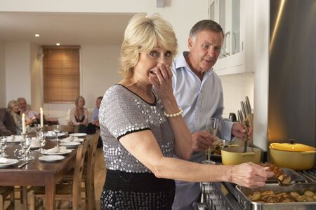 Couple Having Difficulty Cooking For A Dinner Party photo