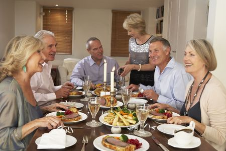 dinner party people: Friends At A Dinner Party Stock Photo