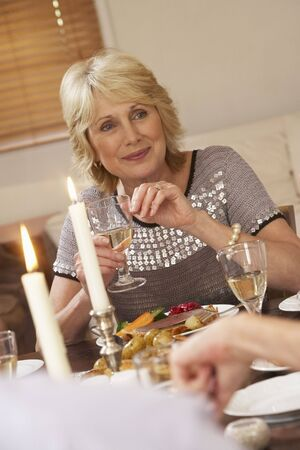 Woman Eating Dinner At Home photo