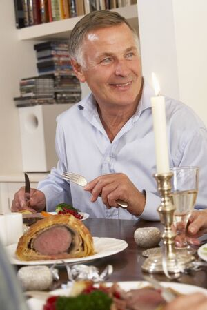 Man Eating Dinner At Home photo