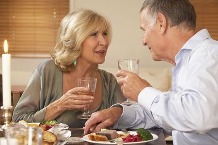 dinner party people: Couple Enjoying A Meal At Home Together
