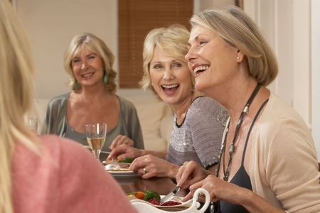 women talking: Friends At A Dinner Party Stock Photo