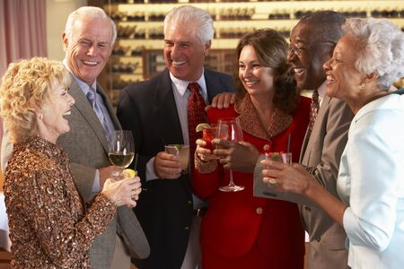 Friends Socializing At A Bar photo