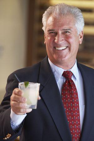 Man Having A Drink At A Bar photo
