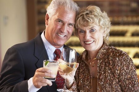 Couple Enjoying A Drink At A Bar Together photo