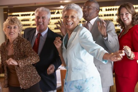 older people: Couples Dancing Together At A Nightclub Stock Photo