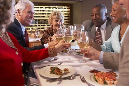 socializing: Friends Having Dinner Together At A Restaurant