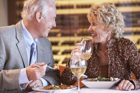 Senior Couple Having Dinner Together At A Restaurant photo