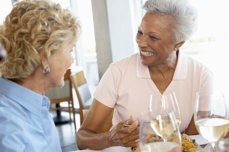 older women: Friends Having Lunch Together At A Restaurant