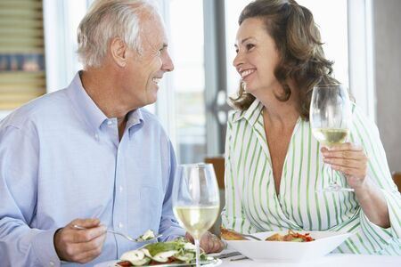 Senior Couple Having Lunch Together At A Restaurant photo