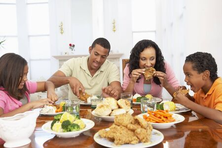 child food: Family Having A Meal Together At Home