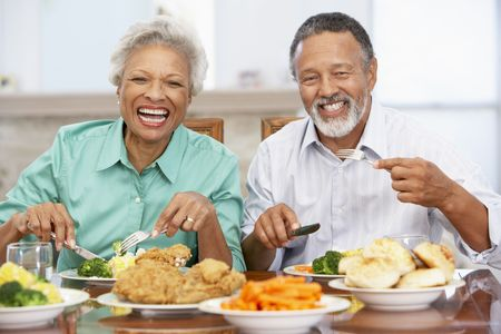 senior at home: Couple Having Lunch Together At Home