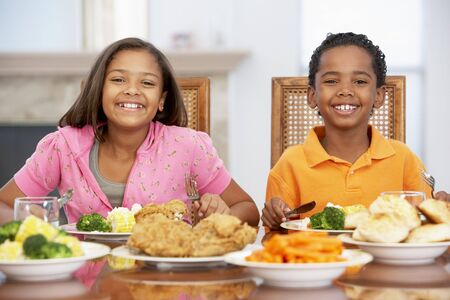 kids food: Brother And Sister Having Lunch Together At Home