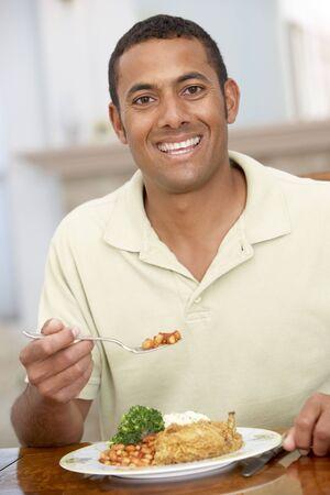 Man Enjoying A Meal At Home photo