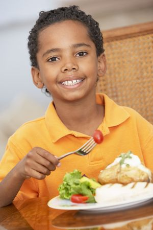 Young Boy Enjoying A Meal At Home photo