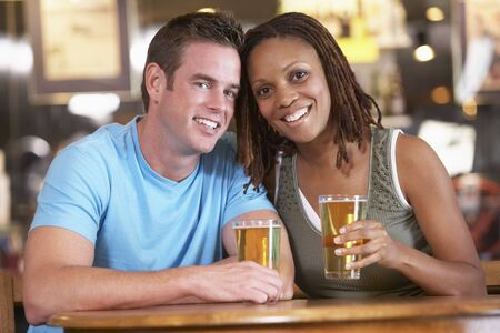 Couple Drinking Beer Together In A Pub Stock Photo - 4645920