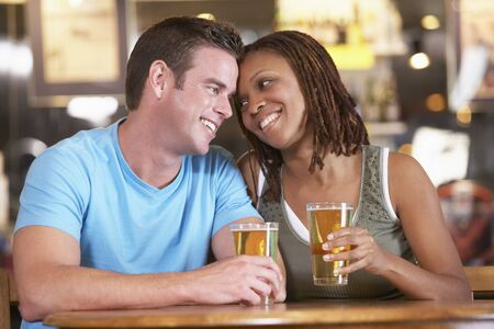 Couple Drinking Beer Together In A Pub Stock Photo - 4646028