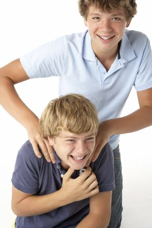 boy 15 year old: Two Brothers Playing Stock Photo