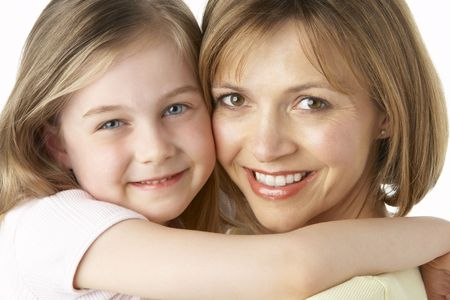 Mother And Daughter Smiling And Hugging photo