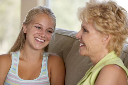 two people talking: Mother And Daughter Together At Home