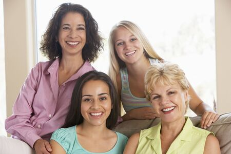 friends and family: Two Women And Their Teenage Daughters Stock Photo