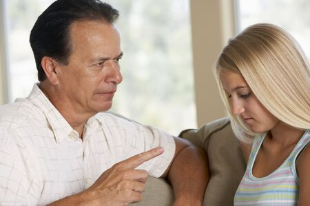 Man Having A Serious Talk With His Daughter photo